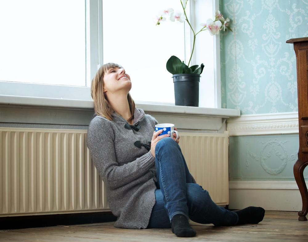 Woman next to a radiator