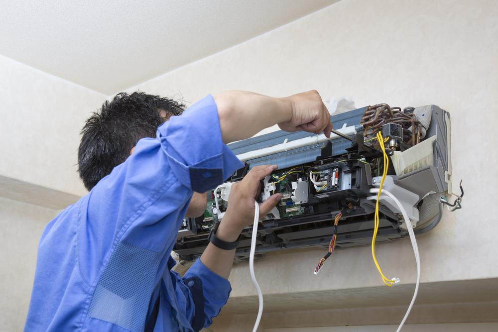 Technician working on an air conditioner