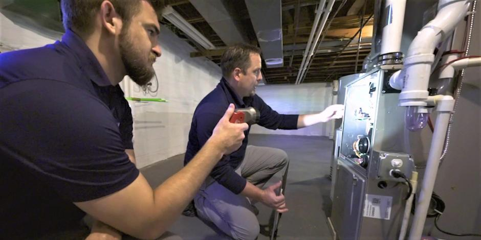 Fred F. Collis and Sons team performing an energy audit