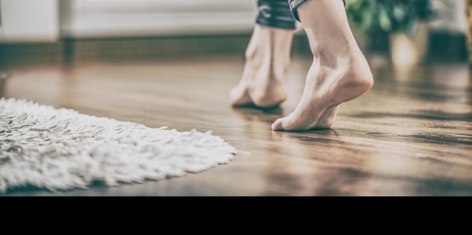 lower legs of woman barefoot at home