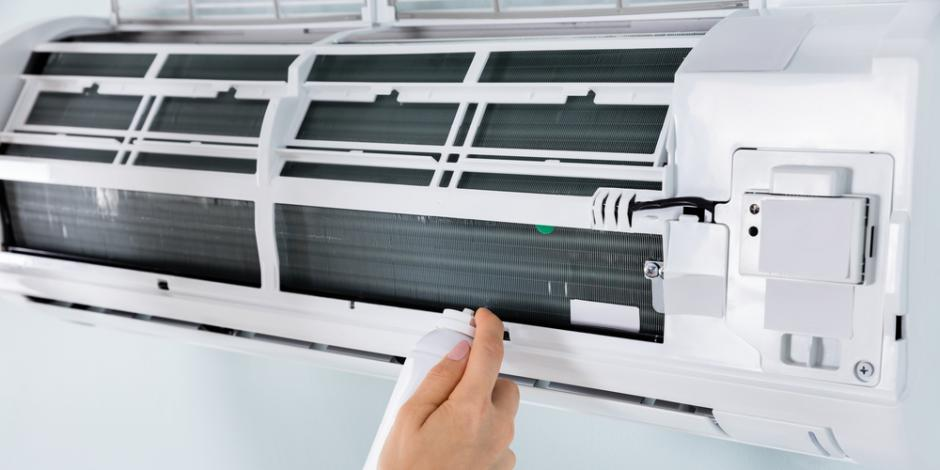 cleaning inside an air conditioning unit inside home