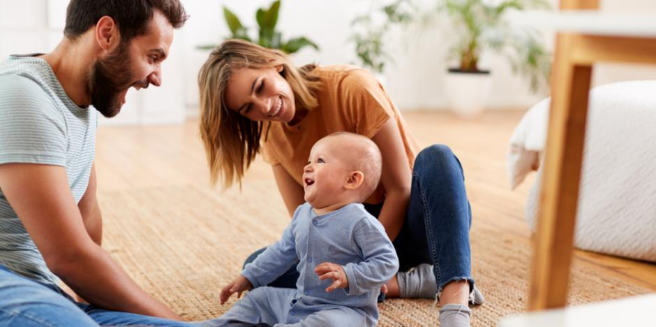 Parents sitting with a baby on the floor